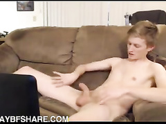 Young pale fellow plays with his cock in the hall