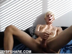 Blond boy fingers his ass during masturbation