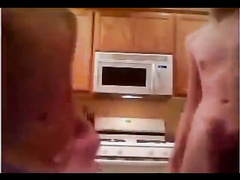 Teen guy is jerking off his cock in the kitchen