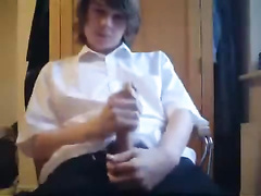 Nicely dressed up blonde kid is jerking off his dick