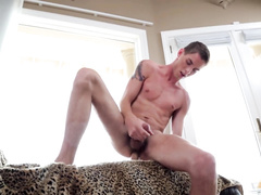 Tattooed man doesn't stop jerking off his dick