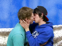 Naughty teen boyfriend are excitingly kissing on couch