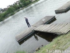Sexy shaped young guy gets filmed peeing by the river