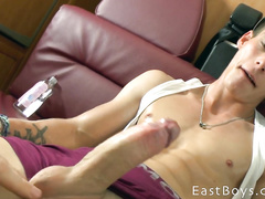 Charming twink in  baseball cap and with pierced ears is pleasuring handjob