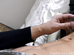 Twink shows his body on balcony and enjoys handjob on couch