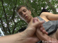 Teen guy got his huge young dick pleasantly handjobbed outdoors