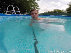 Young gay is making selfie pictures nude in the pool