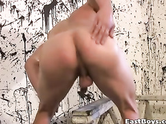 Hot and sexy muscled painter is excitingly posing nude