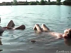 Teen gay boyfriends are swimming in lake nude