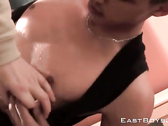 Sexy gay shows off his body and gets sexily oiled up