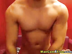 Adorable young gay dude excitingly poses nude