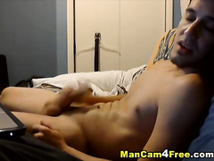 Sexy shaped young twink is pleasantly wanking off on gay porn