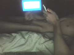 Teen skinny twink is jerking off big dick on the bed in front of the camera